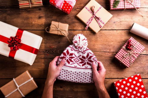 47964543 - christmas presents laid on a wooden table background